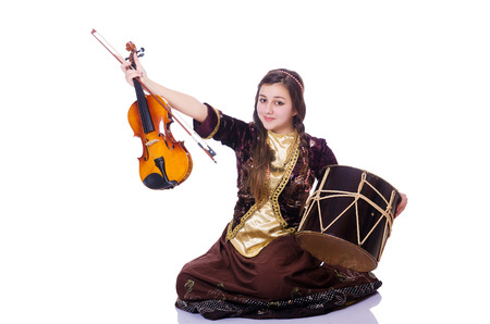 Young woman playing musical instruments on white photo