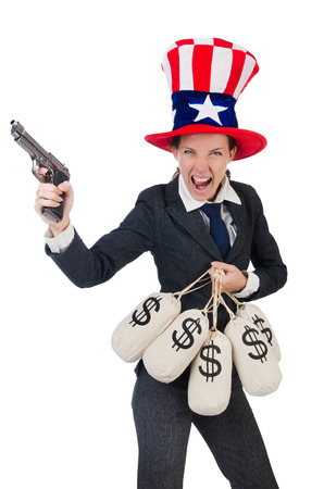Businesswoman with sacks of money and gun isolated on white Stock Photo - 30284362