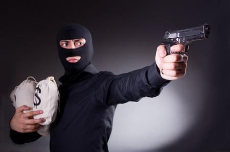 youth crime: Man wearing balaclava with gun