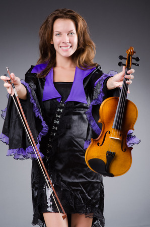 Woman artist with violin in music concept Stock Photo - 30284787