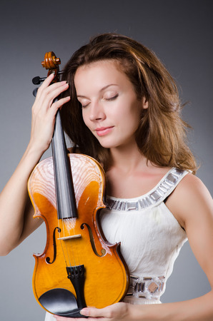 Woman artist with violin in music concept Stock Photo - 30284789