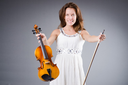 Woman artist with violin in music concept Stock Photo - 30285095