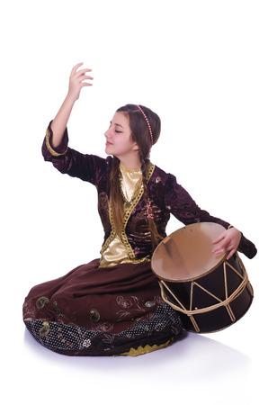 Young azeri woman playing traditional drum nagara Stock Photo - 30414484