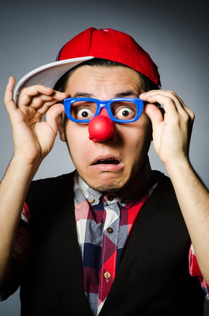 entertainers: Funny clown against the dark background Stock Photo