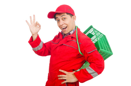 Man in red coveralls with shopping supermarket cart trolley photo