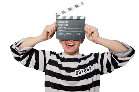 escaping: Funny prison inmate hold a clapboard Stock Photo