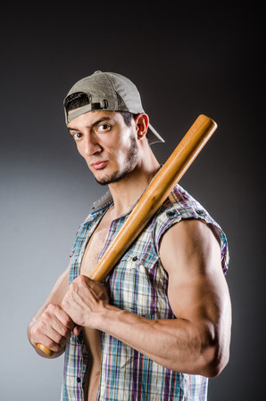 Violent man with baseball bat and hat photo