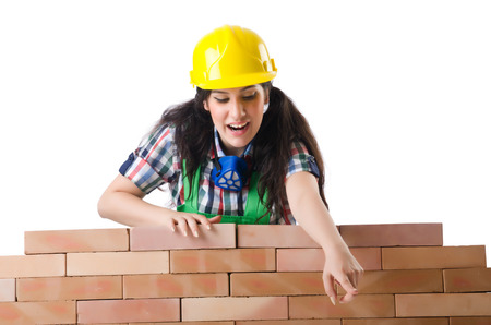 Woman builder isolated on the white photo