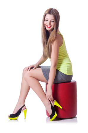 Young woman trying new shoes isolated on white photo