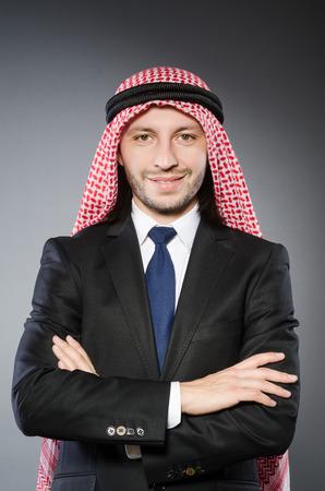 thoub: Arab businessman againt grey background Stock Photo
