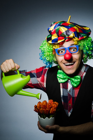 buffoon: Funny clown with watering can