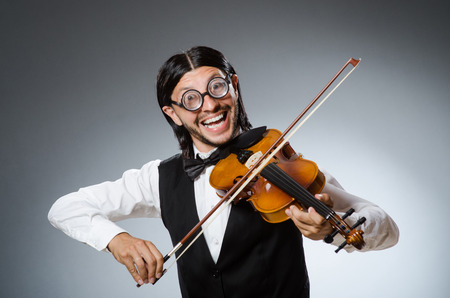 concerto: Funny fiddle violin player in musical concept