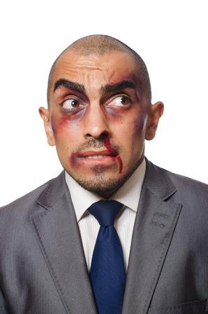 badly: Badly beaten businessman isolated on white Stock Photo