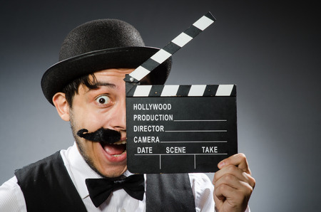 Funny man with movie clapper board  photo