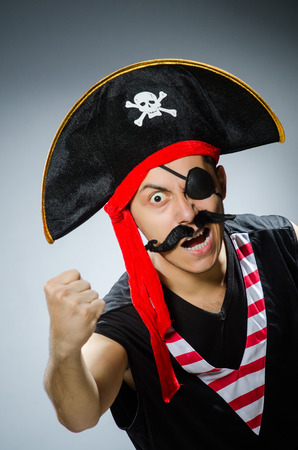 Funny pirate in the dark studio photo