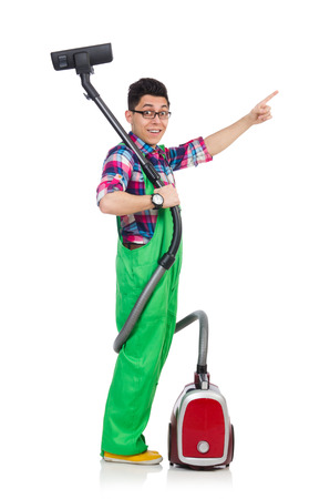 Funny man in green coveralls vacuum cleaning photo