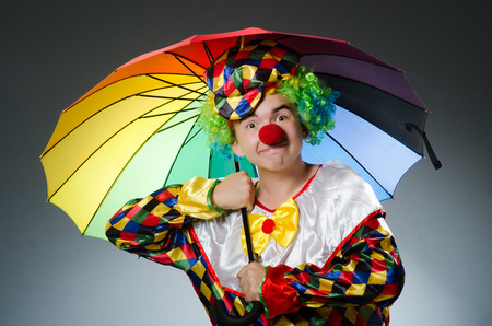 buffoon: Funny clown with colourful umbrella
