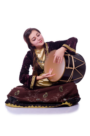 Young azeri woman playing traditional drum nagara photo