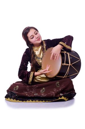 nagara: Young azeri woman playing traditional drum nagara Stock Photo
