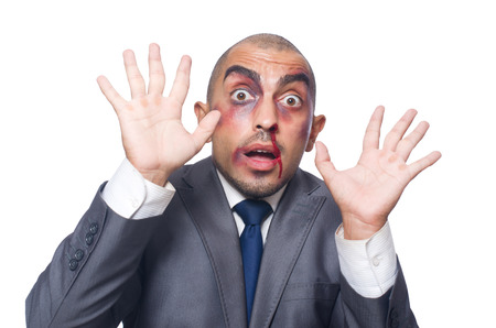Badly beaten businessman isolated on white Stock Photo - 30735227