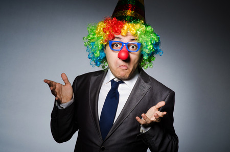 buffoon: Clown businessman in funny concept