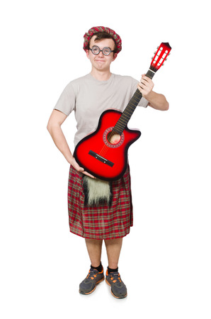 Scotsman playing guitar isolated on white photo