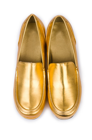 opentoe: Golden woman shoes isolated on the white