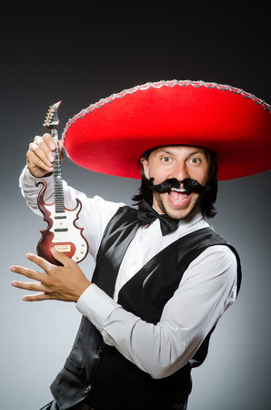 Mexican man with guitar in music concept photo