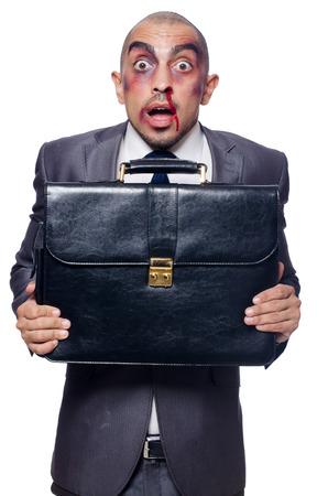 Badly beaten businessman isolated on white Stock Photo - 30841654
