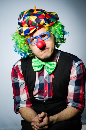 buffoon: Funny clown against the dark background Stock Photo