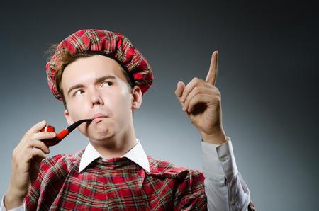 Funny scotsman smoking pipe tobacco photo