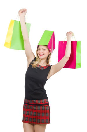 Woman after shopping spree on white photo