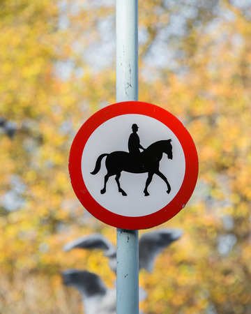 Road sign with horse patrol icon photo
