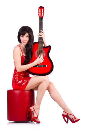 Woman in red dress playing guitar isolated on the white photo