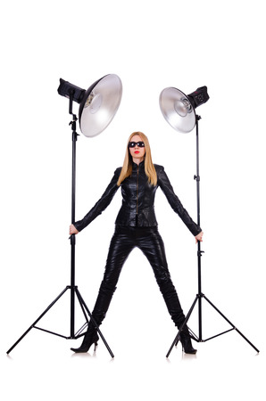 shootout: Woman in black leather dress in studio shootout Stock Photo