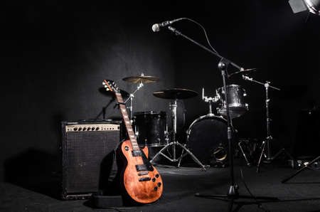 during: Set of musical instruments during concert Stock Photo