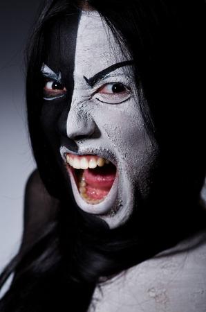 Satan halloween concept with scary woman photo