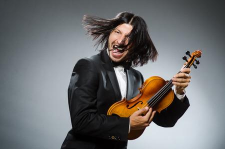 fiddlestick: Man violin player in musican concept
