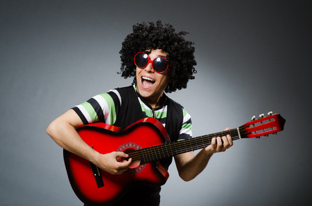 afrocut: man with funny haircut and guitar