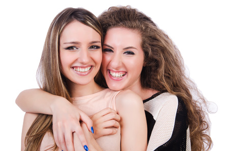 girl sit: Two female friends isolated on the white