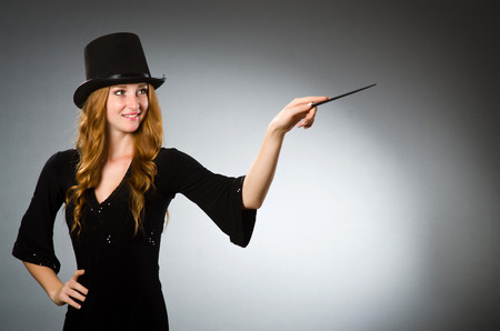 magic hat: Woman magician doing her tricks with wand