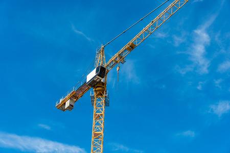 Construction crane next to the building photo