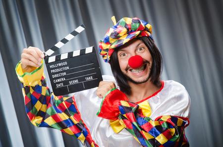 clapper: Clown with movie clapper board