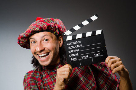 Funny scotsman with movie clapboard photo