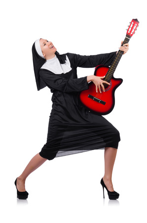 Nun with guitar isolated on the white photo