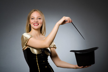 Woman magician with magic wand and hat Stock Photo