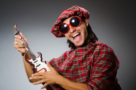 sporran: Funny scotsman playing red guitar