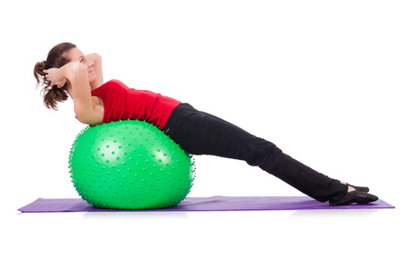swiss ball: Young woman exercising with swiss ball Stock Photo