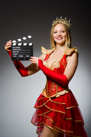 clapboard: Queen in red dress with movie clapboard
