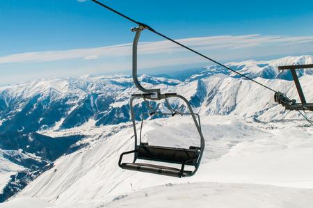 Skilift on ski resort during winter on bright day Stock Photo